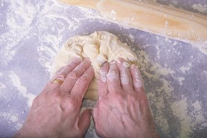 Making dough by female hands on wood