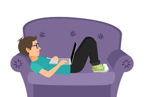 Gamer man lying on sofa with laptop