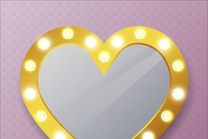 Mirror in shape of heart on wall