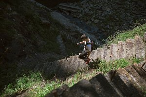 Ultra trail runner down some stairs