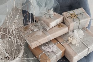 Wrapped gift boxes with silver Christmas ornaments
