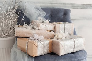 Wrapped gift boxes with ribbons as Christmas presents