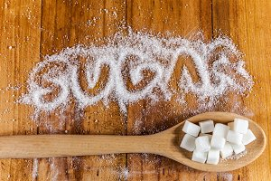 'Sugar' written and cubes on spoon