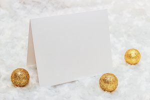 Mockup. White card, golden Christmas