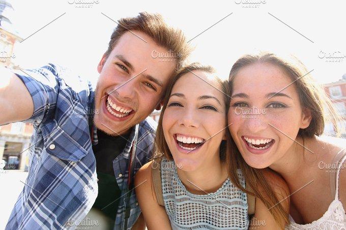 Group of teen friends taking a selfie.jpg - People