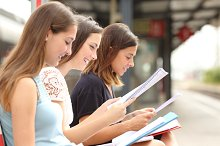 Three students studying and learning in a train station.jpg
