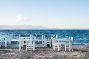 Chairs & tables in cafe near the sea