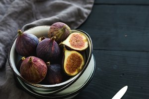 Rustic metal bowl of fresh figs