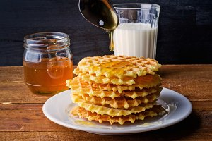 homemade waffles with honey and milk