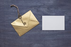 Gold envelope with key