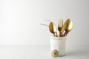 Festive golden cutlery knife and for
