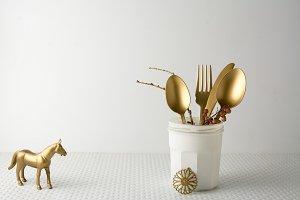 Festive golden cutlery