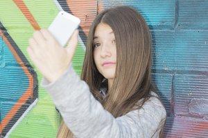 Teenage girl do a selfie