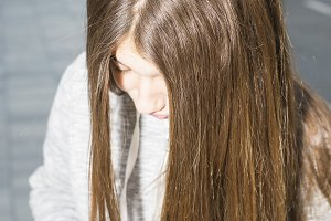 Teenager with long hair