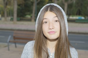 Closeup of hooded teenager