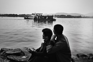 Couple beside lake