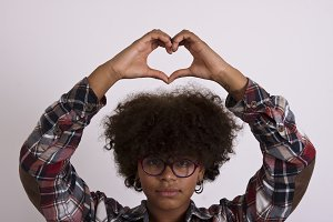 girl with heart-shaped hands