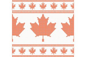 Knitted pattern with red maple leaf