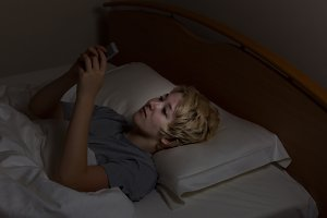 Teen girl texting late at night