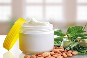 Almond moisturizer cream jar open
