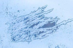 frosty pattern on frozen window