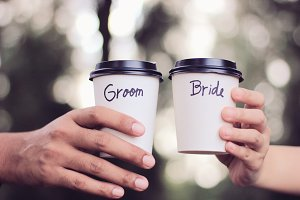 Groom and bride on coffee cup