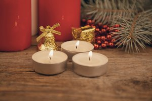 Three burning Christmas candles