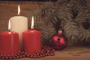 Three burning Christmas candles