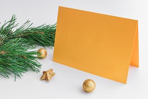 Mockup. Gold card, Christmas balls