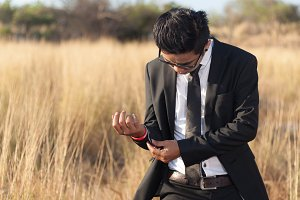 Asian male wearing a black suit