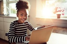Smiling ethnic girl with a laptop