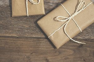 Three gifts wrapped in brown paper