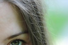 half of face young beautiful woman