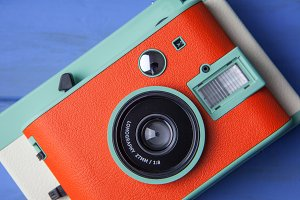 Cute orange retro camera closeup