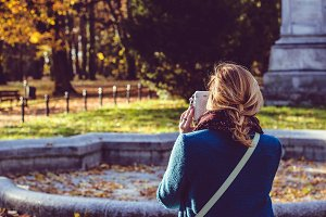 Girl taking picture in the park