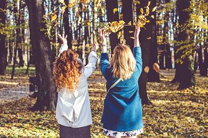 Girls throwing leaves