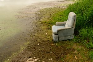 Old Recliner on Swampy Shore