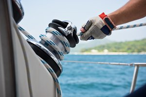 Winch and sailors hands