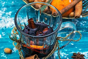 drink mulled wine on bright blue bac