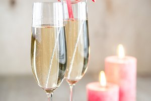 Glasses of champagne in candlelit