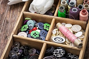 sewing buttons against background of