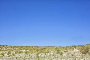 Dune with blue sky