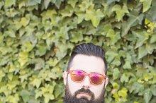 Man with a beard and sunglass