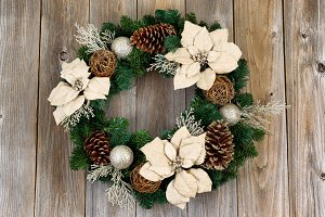White Poinsettia Wreath on aged wood