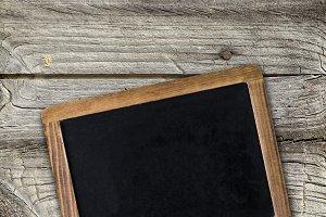 Empty chalkboard on wooden surface