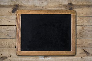 Empty chalkboard on wooden surface