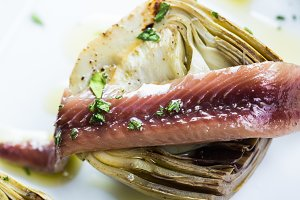 Grilled artichokes with anchovies