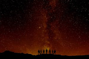 People Silhouettes and star sky
