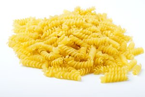 raw pasta on a white background