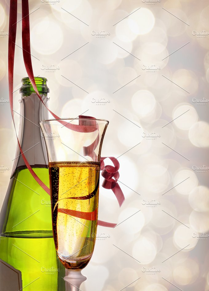 Glass and bottle of sparkling white wine and ribbons hanging.jpg - Food & Drink